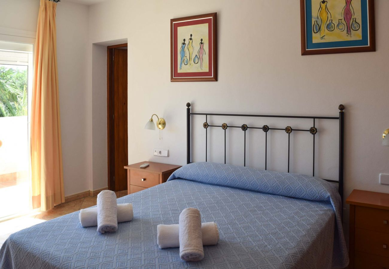 Uno de los cuatro dormitorios de Villa Coqueta